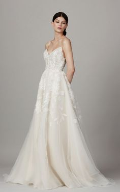 Chic spaghetti strap V-neck wedding dress with embroidered floral, stem and leaf design; Featured Dress: Lela Rose