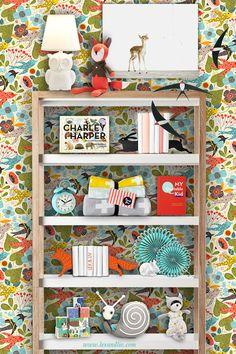 fun wallpaper behind kid's bookshelf