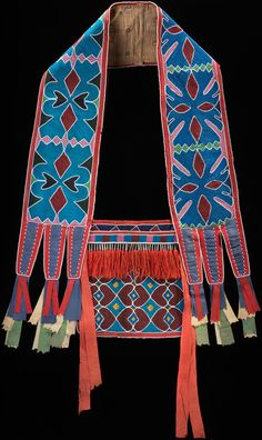 Delaware bandolier bag  ca. 1850  Oklahoma  Hide, cotton cloth, silk ribbon, glass beads, wool yarn, metal cones