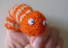 A range of extremely groovy, and unusual, free knitting patterns - including charmers such as this fellow, Smiley the Worm Finger Puppet Finger Puppet Patterns, Animal Knitting Patterns, Puppet Crafts, Puppet Making, Homemade Toys, Homemade Puppets, Knitted Animals, Chenille, Hand Puppets