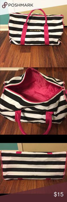 VS Weekend Getaway Bag Used Victoria's Secret's Weekend Getaway Bag! Black and White with pink handles and pink strap. No rips, but there are a few places on the bottom and top that are worn (pictures included). Perfect for a Weekend Getaway! Victoria's Secret Bags Travel Bags