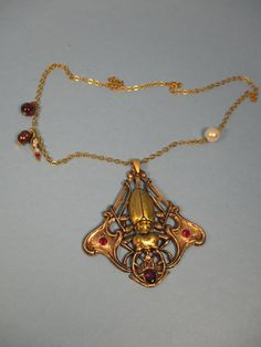 Art Nouveau Beetle with Garnet Pendant by spiritracer. Explore more products on http://spiritracer.etsy.com
