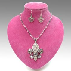 "CHUNKY FLEUR DE LIS THEME SILVER TONE METAL NECKLACE SET WITH  CRYSTAL ACCENTS       NECKLACE: 18"" + 3"" EXT    CHARM: 2.5"" LONG BY 1.9"" WIDE               HOOK EARRINGS                    COLOR: SILVER TONE  $20.99"