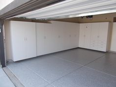 A Roseville family gets their garage ready for move in… Epoxy flooring in RiverRock and White garage cabinets for storage.