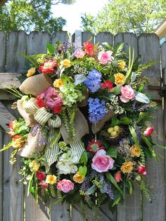 Belle Fleur  Welcome to IvySage Designs! Thank you for taking time to view this beautiful French Country wreath that pops with colorful blooms often seen in the open-air markets of France. Filled with roses, hydrangeas, pin cushions, textured greenery, and a sweet bird nest, this gorgeous design will add flair, warmth, and graciousness to your door. With a combination of burlap and ticking ribbons along with pretty floral stems, this wreath is a home accent piece I hope you will love!  The…