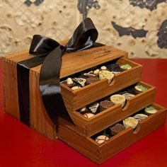 The Chocolate Tier Obsession Wooden Truffle Box, 90 piece Obsession three drawer wooden box beautiful array of our most decadent, delicious pieces makes this the ultimate chocolate gift. Truffle Boxes, Chocolate Gifts, Wooden Boxes, Truffles, Wine Rack, Drawer, Christmas Gifts, Gift Ideas, How To Make