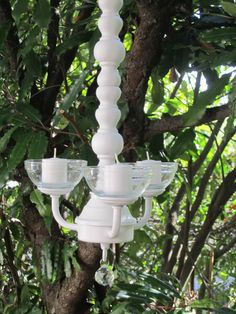 This is a OAK 3 arm Hanging Chandelier Candle Holder, painted Satin White. I hand painted the glass votive holders with blue permanent glass paint.