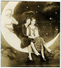 Here are some funny vintage photographs of people posing on or against a giant paper moon in a studio in the past.