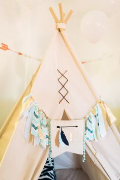 Love these colors! Tribal Pow Wow First Birthday Party | Event Planning, Styling & Design: Manna Sun Events | www.mannasunevents.com |  Photo: Stella Yang Photography