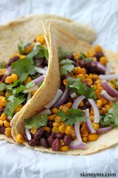 Roasted Corn and Black Bean Tacos - This taco recipe combines with our roasted corn recipe for a scrumptious meat-free meal option and it's made with 100% whole food ingredients. #cleaneating #superfoods