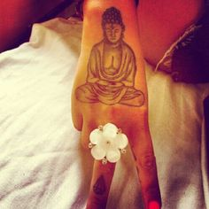 Seriously contemplating a #handtattoo like this one in the near future! #tattoo #buddah #peace #girlswithtattoos by Born And Raised, via Flickr