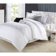 Achieve a contemporary yet elegant look with this 12-piece comforter set in white embroidery with gray accents. This comforter set comes with everything you need for a complete makeover of your master bedroom or guest suite.