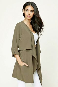 A woven cardigan featuring a draped silhouette, open-front, long sleeves with buttoned epaulettes, and two front on-seam pockets.