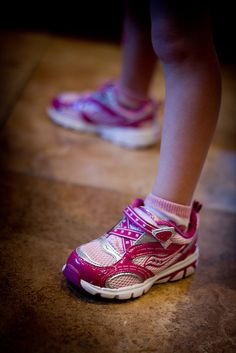 I've mentioned this before, but one of the joys of parenting is shopping for little kid's shoes. Take these for instance. OMG. Adorable. Pink Sauconys. She had a pair of nasty Nike's that she has worn to the bone, and I was so worried she wouldn't gi