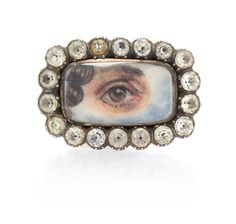 An Antique Gold, Silver and Paste Lover's Eye Brooch, 3.00 dwts.
