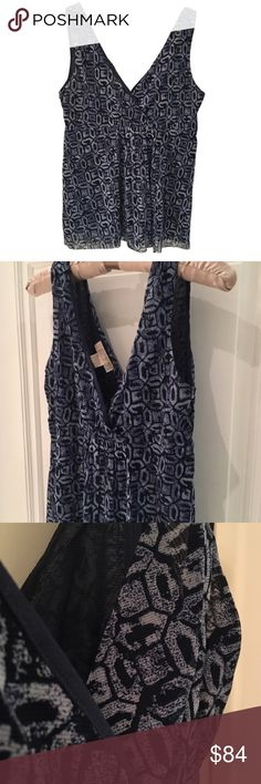 "Michael Kors deep blue patterned V-neck top 🎁Offers encouraged & flexible                                                                                🔑Bundle to save 10%                                                                                                   👍Like for price drop notifications                                     EUC, no stains spots or loose threads. Mesh like under layer. Top to hem~ 25.5"", neckline to hem~ 16"", breast width~ 14"". Elastic fit at center (could…"