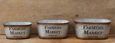 "These tin farmers market buckets come as as a set of 3 and can be used as home decor, planters, storage, or just about anything for that matter!    The buckets measure as follows: LG: 12"" W x 7.25"" D x 6""H; MD: 11"" W x 6.25"" D x 5.5 H; SM: 9.5"" W x 5.5"" D x 5"" H."