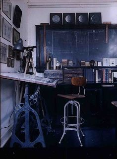 Workspace - faux wall from bookshelf to separate space - chalkboard on wall - moon phases