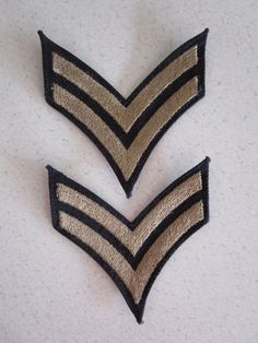 Two world war two army corporal chevron arm patches.   Measurement:  almost 3 1/4 inches long x about 3 inches tall.