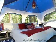 this is a really fun post with many photos from the blogger's camping (glamping) trip!  The red chandelier is operated by battery candles and LED string lights.