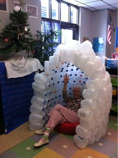 Build an igloo from empty milk cartoons as part of winter writing pieces.