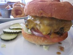GREEN CHILE CHEESEBURGER:  cheddar cheese & roasted  green chile.  Holy Cow - Albuquerque, NM  photo by: Jessi Almanzar