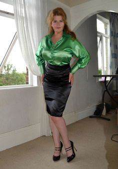 Green satin blouse with black satin pencil skirt