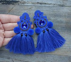 Earrings made by soutache embroidery. Decorated in the style of boho, with pompoms and tassels. materials: soutache straps, glass, faceted cabochons, toho beads, hand-made tassels, pompons; The length of the earrings is 10 cm (3.9 inch). weight of one earring: 7.2 grams Earrings are