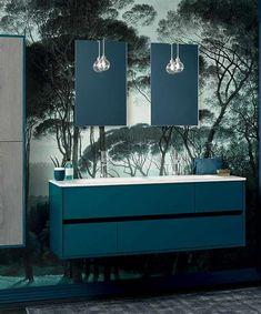 Ce meuble vasque laqué bleu canard de la gamme Frame est sublimé par le papier peint effet jungle. La colonne de rangement en bois apporte une touche de naturel en plus dans cette salle de bain originale. - frame de Sanijura  #sanijura #salledebain #bathroom #bathroomfurniture #bathroomgoals #design #deco #decoration #interiorinspiration #interiordesign #bleucanard #blue #modern #moderne Decoration, Storage, Furniture, Home Decor, Design, Blue Armchair, Quirky Bathroom, Color Of The Year, Homemade Home Decor