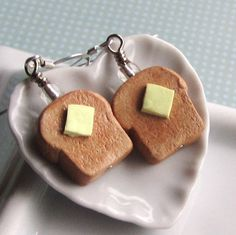 Hey, I found this really awesome Etsy listing at http://www.etsy.com/listing/85860733/buttered-toast-earrings