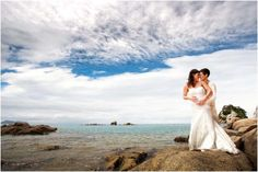 Lesbian couple at a beach wedding New Zealand-Great picture!