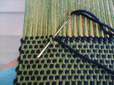 hem stitching needle insertion, top of piece