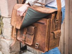 Scaramanga's largest and most spacious leather bag. The Overlander combines the spaciousness of a pilot's case with the retro style of our best selling vintage leather satchels. Leather Laptop Bag, Leather Briefcase, Leather Satchel, Travel Bag, Travel Gifts, One Bag, A 17, Leather Accessories, Vintage Leather