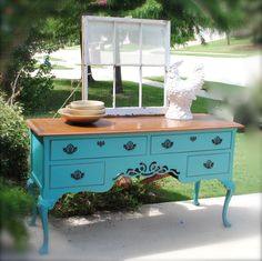 Laura Camry Boutique~This beautiful buffet has been refurbished with a new coat of paint and has lightly distressed edges.  I left the top stained to give it a little more character. Find more at http://www.facebook.com/lauracamryboutique