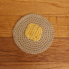 lsquaredyarn:: Custom request:  A crazy cake (pancake) with a pat of butter weighted for a menu-weight.  Hope this passes muster!  #crochet #amigurumi #pancake #crochetfood #dontactuallyeatthese #toddlermarket  #farmersmarket #handmade #lsquaredyarnworks #winningathashtags