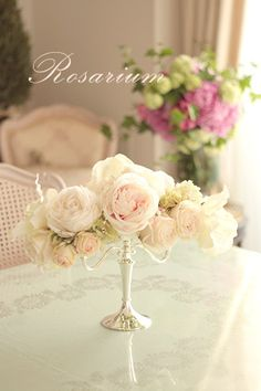 Vintage French Soul ~ Candelabras aren't just for candles ... faded silk roses make this so beautiful