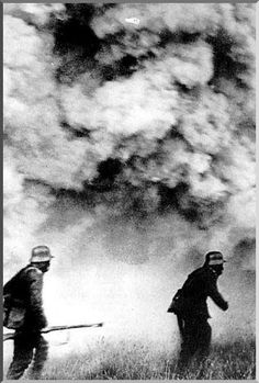Wearing gas masks, German soldiers wade through a gas attack by the British, World War I.