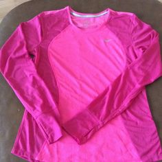 Never worn Nike Long Sleeve Two tone pink long sleeve.  Thumbholes and vented detail on back make this a perfect layer for chilly spring workouts! Nike Tops Tees - Long Sleeve