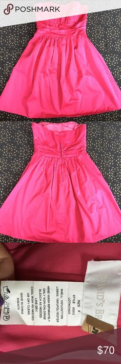 Womens pink strapless dress with pockets Beautiful pink strapless  dress size 6 with pockets has a zipper and hook in back worn once like new. Been dry cleaned so it is ready to wear!!  this dress and that it has pretty decent size pockets!!!!  David's Bridal Dresses Strapless