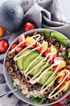 Quick and easy ground beef taco bowls are healthy and loaded with flavor. Filled with ground beef, cauliflower rice, spinach and your favorite toppings. Paleo, Gluten-Free, Dairy-Free + Whole 30. | realsimplegood.com