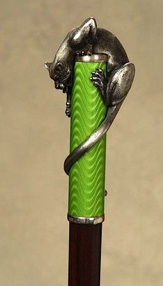 A french 1920's silver panther on green enamel Walking Stick