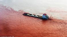Dirty/clean: A ship sails across the junction of the Yangtze River and the Jialin River at the exact spot where the dyed river starts to bleed into the Jialin