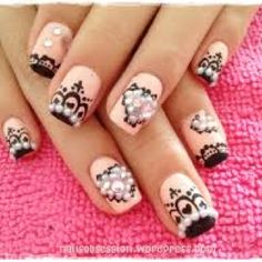 Crown & pearls nail art, not sure about the ring finger, but like the rest