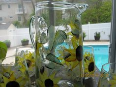 Pitcher hand painted with sunflowers and green by ingeborgsorgent