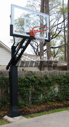 "Mega Slam 660 installed on a driveway court.  Professional grade system with 60"" backboard, 6"" x 6"" base pole, 1/2"" tempered glass, and 3' overhang."
