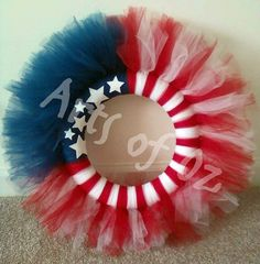 """There's nothing that can show your American pride like this 12"""" USA Flag wreath with White Stars! Made with red, white, and blue tulle with white glitter stars."""