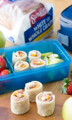 Ham & Cheese Sushi Rolls: Surprise your kids with this fun school lunch that disguises a ham, Cheddar and pickle sandwich as sushi! Your kids will love the flavor on Sara Lee White Made with Whole Grain Bread.