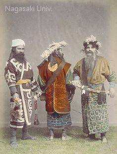 Three Ainu men wearing ethnic costumes. They wear beards, hats and decorative swords.  about 1890's by Ogawa,Kazumasa #Japan #Ainu