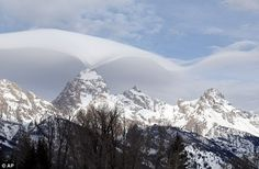 Grand Teton taken over by rare wispy clouds that roll over Wyoming mountain range at Grand Teton National Park | Daily Mail Online