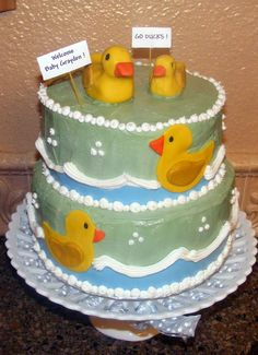 baby shower cake frosting and fondont cut outs... ducks are formed with fondont